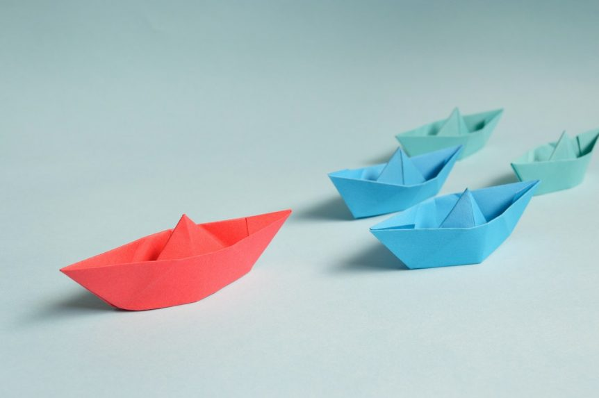 leader-paper-boats-on-solid-surface