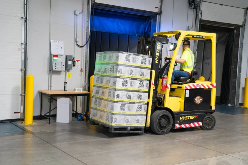 man-riding-on-yellow-forklift