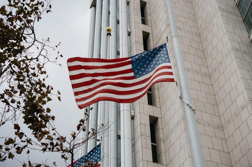 usa-flag-waving-on-white-pole